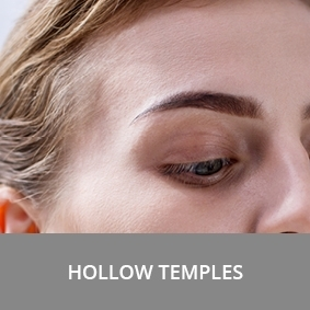 Hollow temples on the face of woman