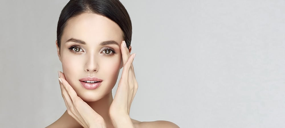 Mesotherapy banner featured image of a beautiful young woman with big brown eyes and dark hair