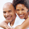 Bioidentical Hormone Replacement Therapy - eature image of happy couple hugging and looking at the camera.