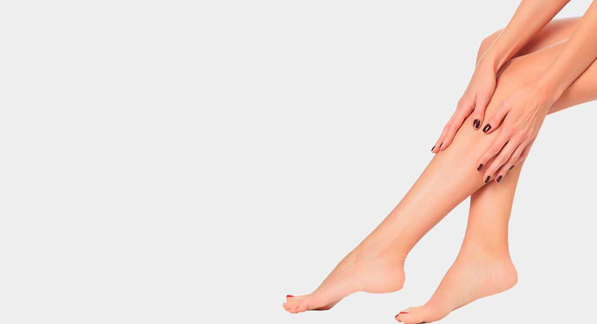 Feature image used for calf reduction treatment of woman's legs where she is touching her calf