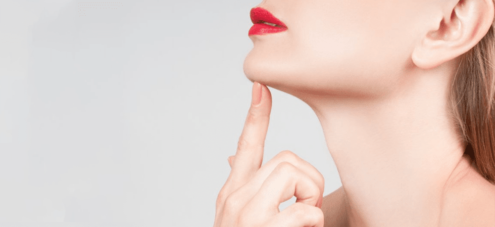 woman's profile, touching her chin. Background image for facetite treatment.