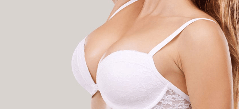 The Vampire Breast Lift - Woman in white bra background image for vampire breast lift treatment.